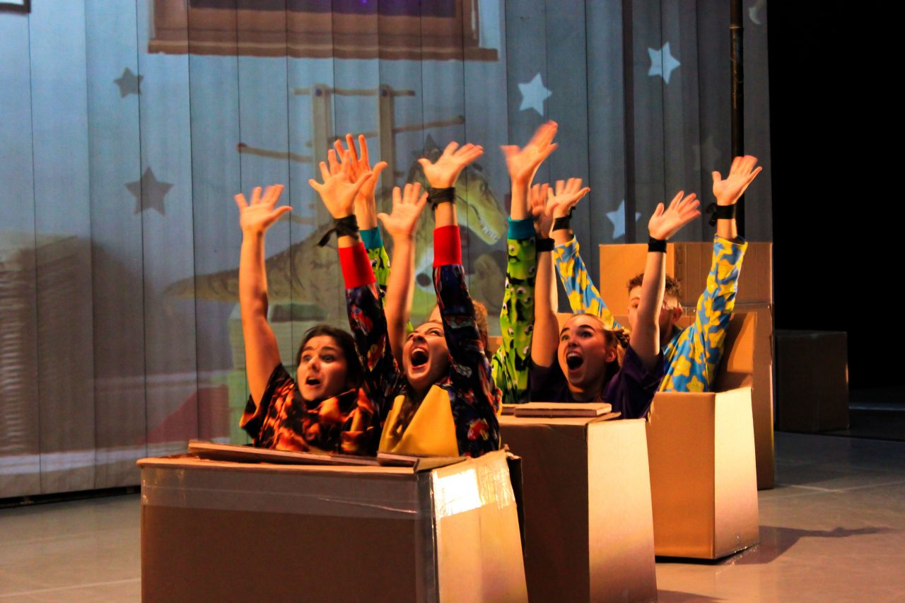 Motionhouse dancers in a cardboard roller coaster