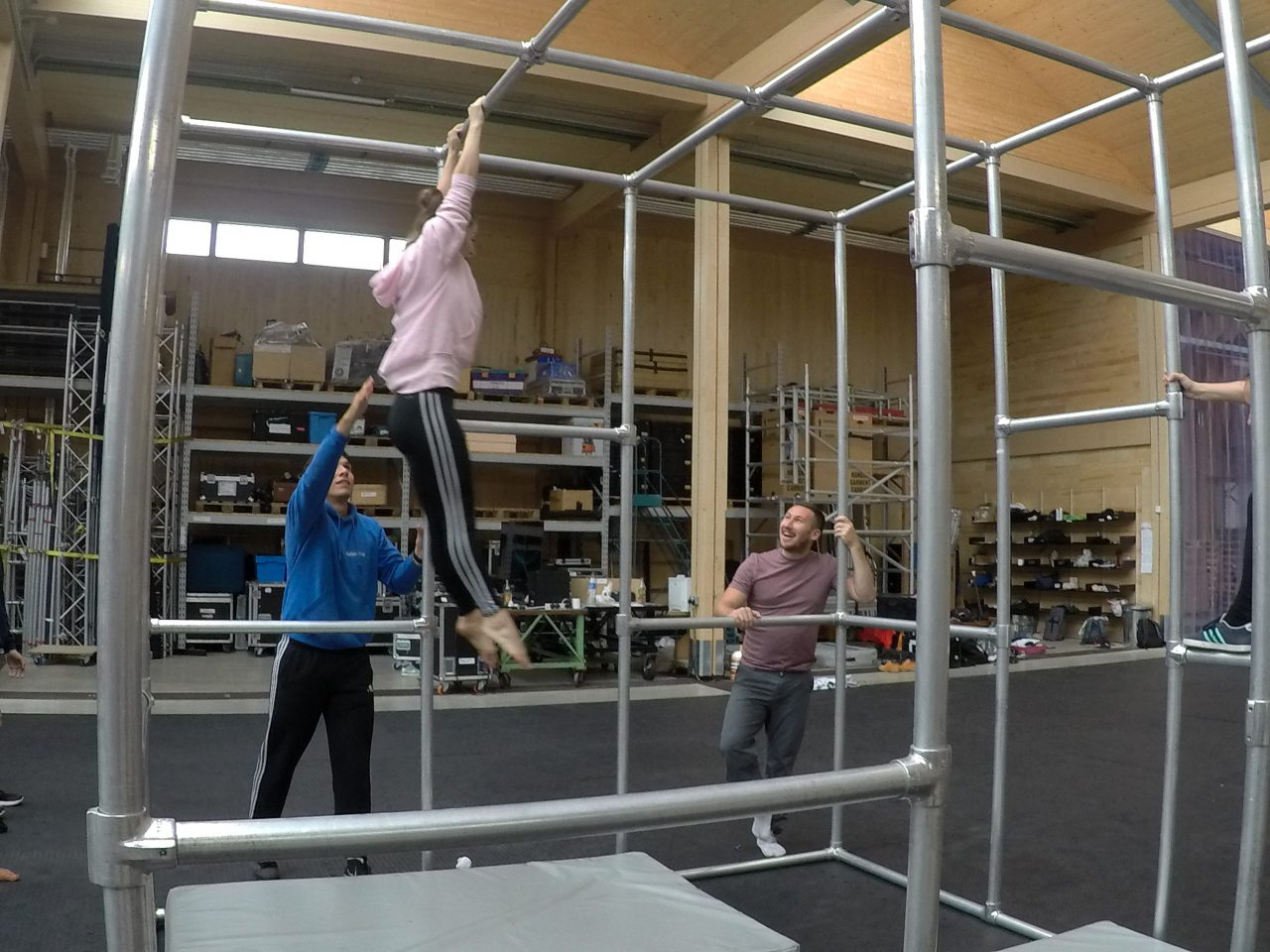 Danny supervising student swinging in the Captive cage